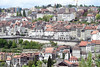 The Tour de Romandie is dwarfed by the buildings in Fribourg as it makes its way out of the city...