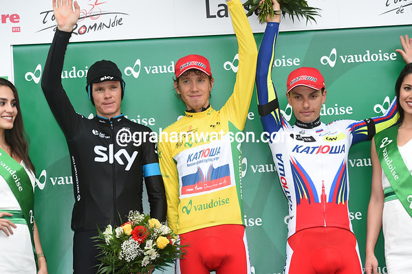 Illun Zakarin celebrates a remarkable win with Simon Spilak and Christopher Froome...