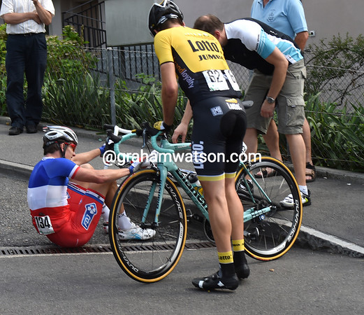 Arnaud Demare has crashed at the foot of the Michaelskreuz with Tom Leezer...
