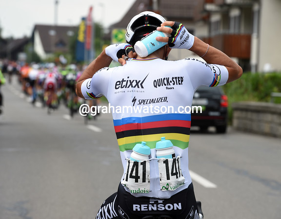 A rare sighting of a World Champion carrying bottles - Michal Kwiatkowski is the champion...