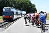 There's a train coming - but on a different carriageway to the Tour de Suisse cyclists...
