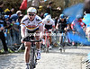 Greipel is the first to the top of the Koppenberg, but the race is truly on behind him...
