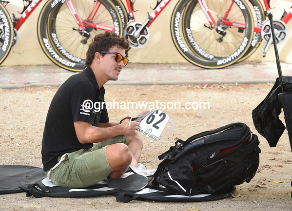 Julian Arredondo gets right down to the ground to prepare his race numbers in the glamour of Al Sewadi...