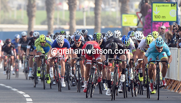 Guardini (right) has been overtaken by a man in black, and Bouhanni's not far behind either...