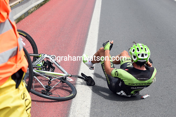 Moreno Moster has touched wheels at the back of the peloton and crashed...