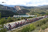 The peloton is dwarfed by its surroundings in a most beautiful part of Spain...