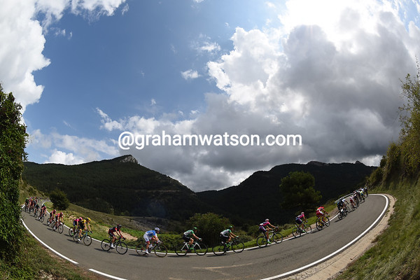 The peloton is strung out on the descent of the Coll de Boixolls...
