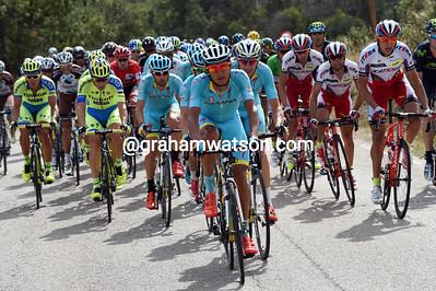 Astana has taken over control of the chase, with Tinkoff to the right and Katusha to the left...