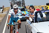 Aru needs some medical attention before continuing - the peloton has sat up to await the Italian...
