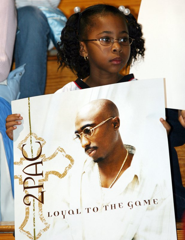 The posters were free and I could not pass the image by.  She maybe to young to understand the rapper or his life, so take the image for what it is worth.