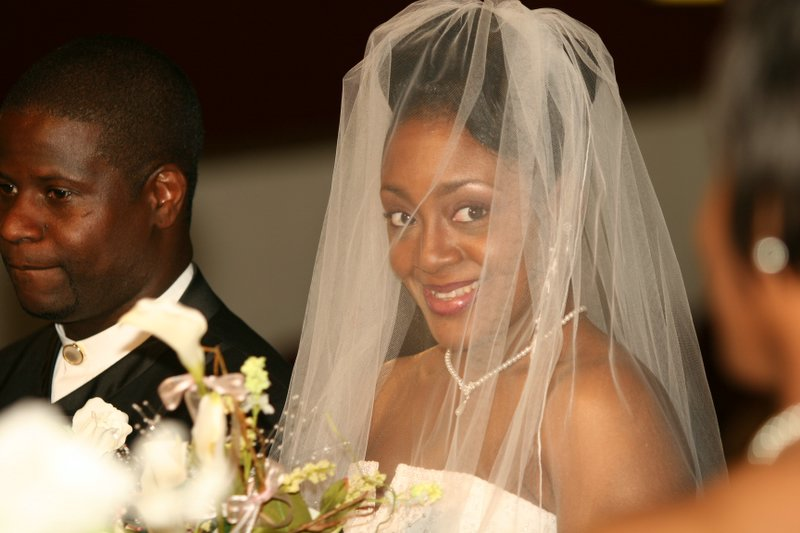 My faviorite wedding moment.  The bride smiles at her maid of honor and the smile says it all.