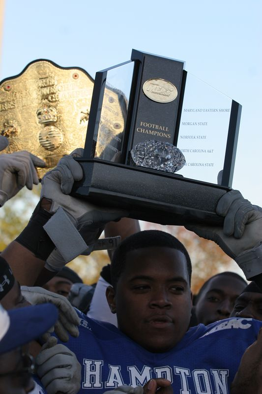 Walking away with the trophy and the belt!