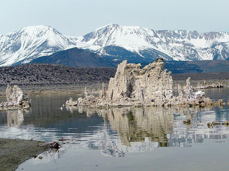 The Osprey nest on top of foreground tufa tower with the Sierra Nevada in background, Mono Lake, eastern California.