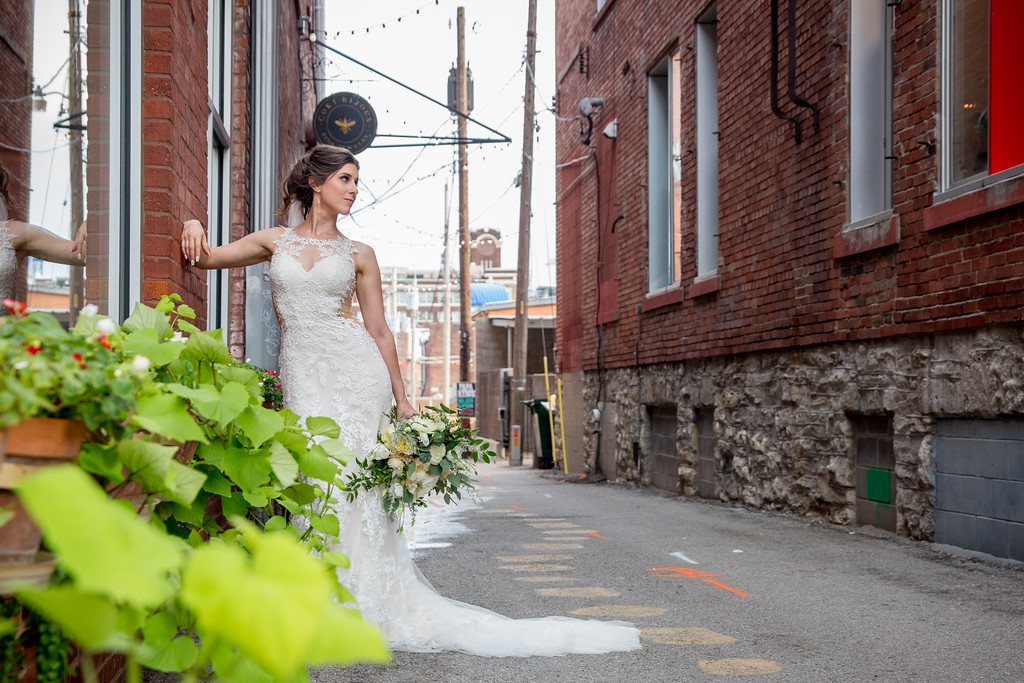 Bridal glamour shot in the alley outside of the wedding venue