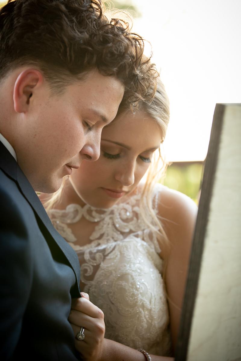 Bride and groom share a prayer