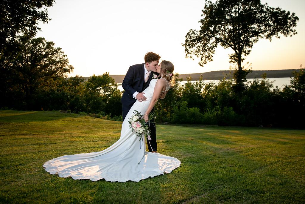 Husband and wife take a likeside photo