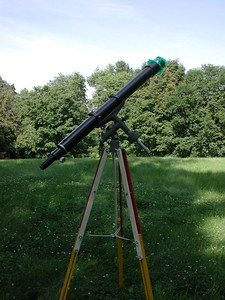 I watched a lot of the 2003 Mars Opposition with this telescope as pictured in my back yard in the summer of that year. This 3.25 inch Jaegers lens is mounted in a homemade telescope. The instrument yeilds very beautiful images! The mount is an Edmund Scientific from late 1960's or early 70's.   The colorful tripod is from a surveyors transit.