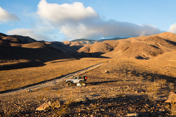 My Jeep camped outside of Johnson Canyon during a windstorm in Death Valley National Park.