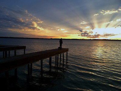 Some color adjustment on this photo to highlight the sunset and rays. Not better, just different than the original.