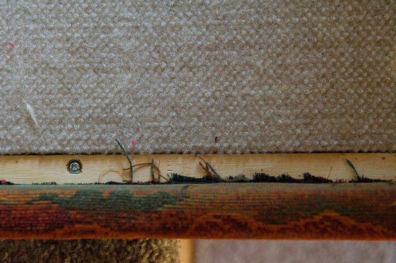 Uneven upholstery trim under dinette seat