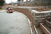 Wall cleaned and extended, sand and gravel base in for patio, and forms in for stairs