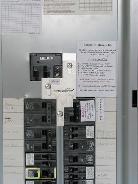 Modified panel with generator breaker and mechanical interlock.