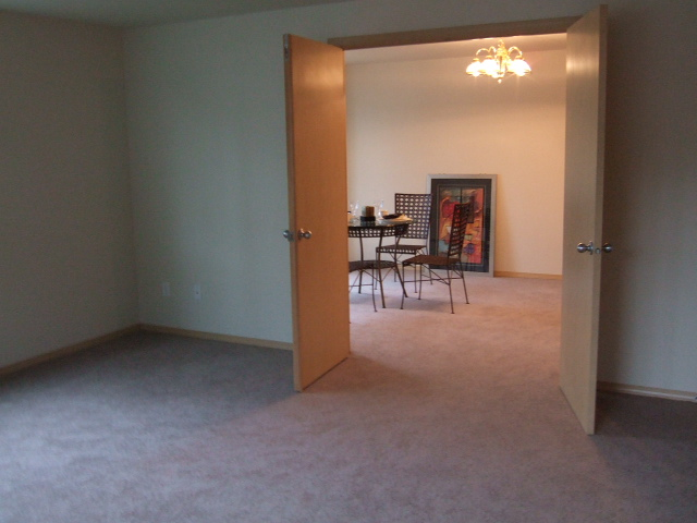 View from front room (standing in front of bay window) looking into formal dining room.