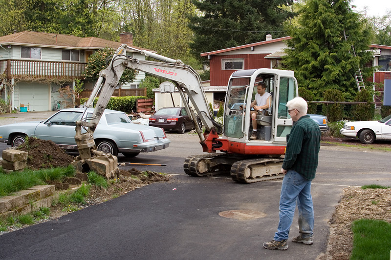 Since we had the excavator there, Clemans also offered to start excavating for the walls.  He turned what would have been several days of manual labor into twenty minutes of machine work.