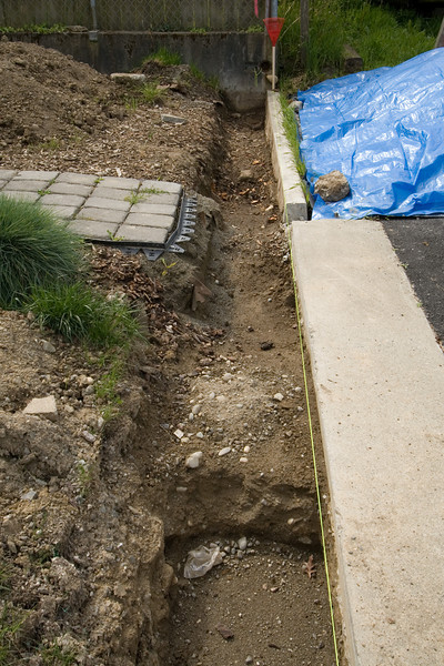 West wall base excavated and leveled.  Step up from two-course depth to one-course depth shown.
