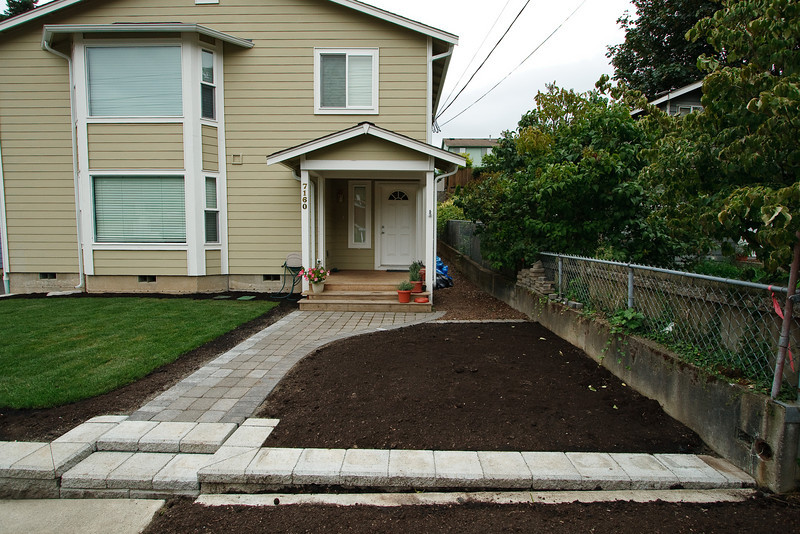 Mulch, pavers, and sprinkler system are done