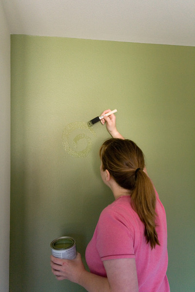 """Sarah paints the first swirl on our new """"Swirl Wall"""""""