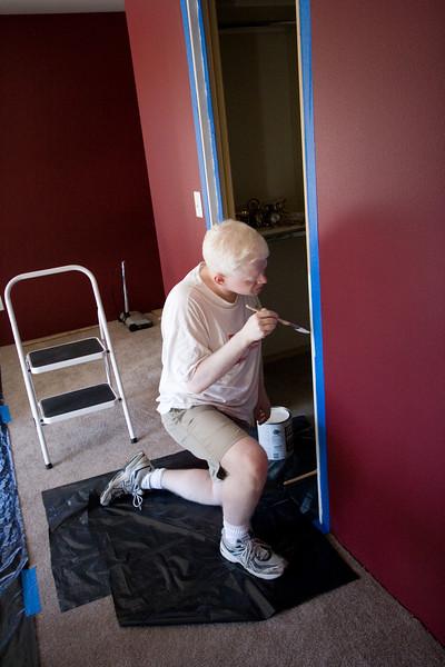 Applying primer to the door jam