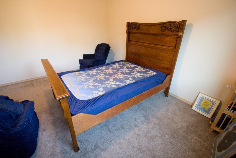 Moving the Ruegg family bed into the North Bedroom