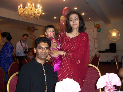 Aliyah Khan with proud parents Munawar and Mona. (Sep 2006)