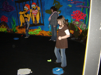 Grace pee-wee golfing at Journey fun house in Fremont