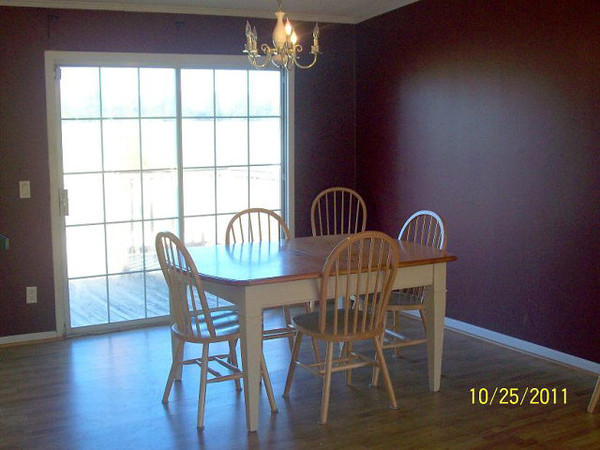 The dining room. Patio doors lead out onto the rear deck.