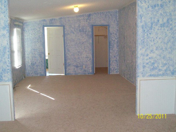 The master bedroom. Doors lead to the bathroom (left) and walk in wardrobe (right).