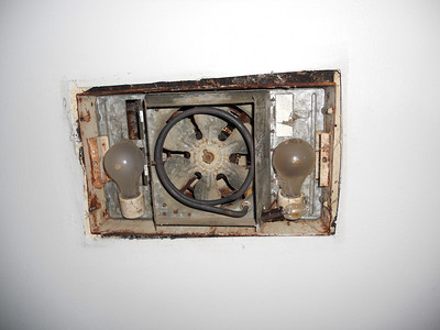 This will eventually get replaced.  A lot of rusting steel up there, but it is 45 years old, and still working!  The fan cowling is galvanized, so it is in really good shape, and not falling apart like the one in the other bathroom was.