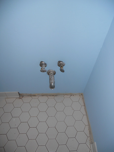 Floor is all cleaned and scrubbed, ready for the new sink.