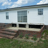 The house with the old deck removed. We are now ready for the guy to come by and build the new one for us.