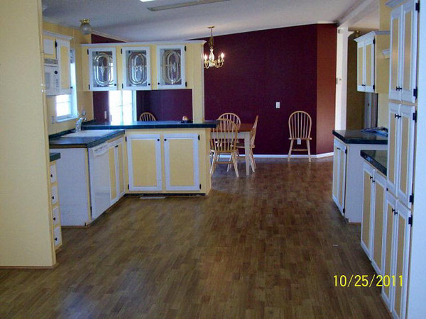 The kitchen from the other end showing the dining area.