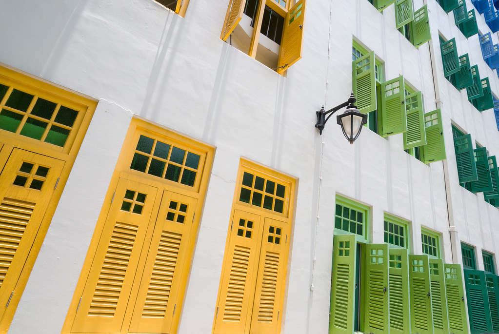 colorful rows of windows in a white wall