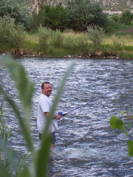 Chris fishes in the Rio Grande. So far he hasn't caught anything.