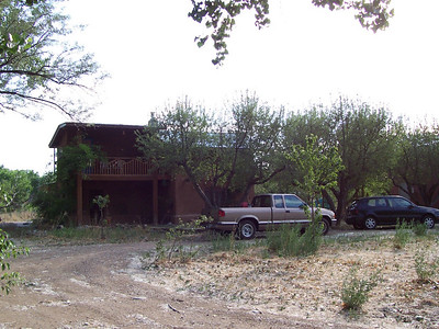 The front of the house with our cars in the circle drive. All three large trees in front are apple trees.