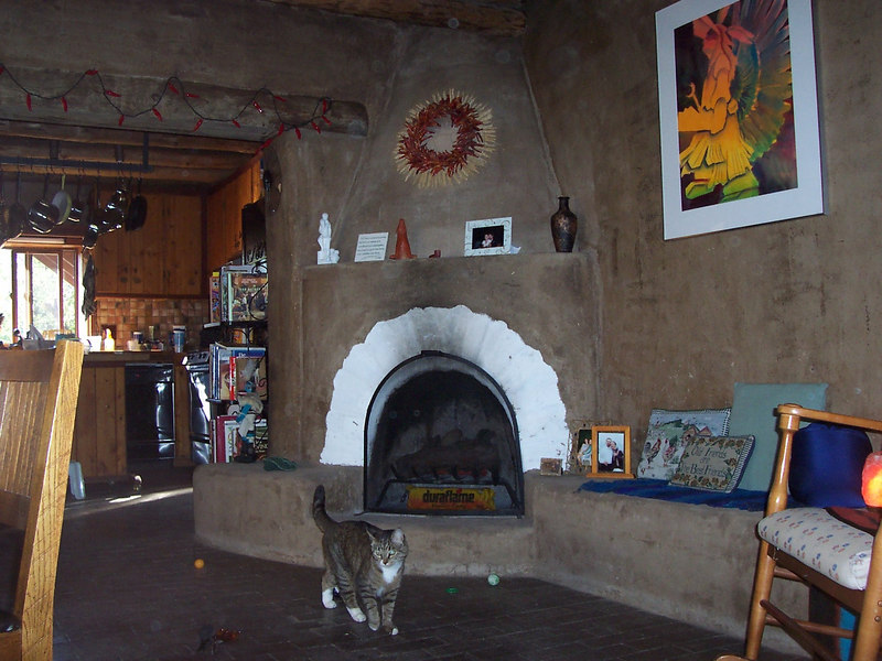 The traditional New Mexican kiva fireplace. We expect the cats to snuggle up to this a lot in the winter. The all adobe walls make this a very cozy room that stays cool in summer and warm in winter.