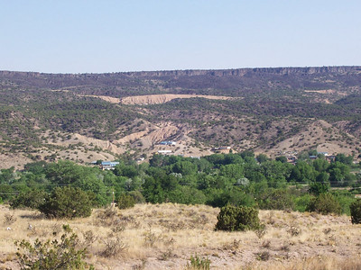Our house is hidden in the middle of the trees in the center of the photo. Looking west from Hwy 68 toward Black Mesa.