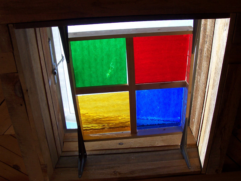 Some of Chris' handywork. The stain-glassed window helps block intense sunlight and heat through the sunroom skylight but still lets the air ventilate.