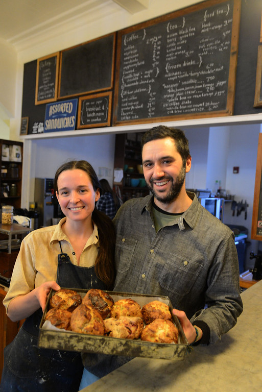 . Tania Barricklo-Daily Freeman  Tarah Gay and Gabriel Constantine, co-owners of the Outdated Cafe on Wal St. in KIngston, hold out a tray of an assortment of biscuits and scones.
