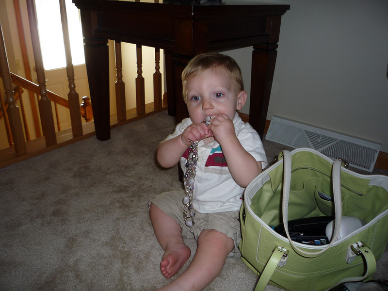 Owen discovers Baba's purse and jewelry.  Wow, this necklace is great for my sore gums.
