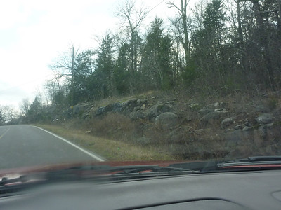 Karst area on county road 9.  Crest of hill you see big sandstone pillars.